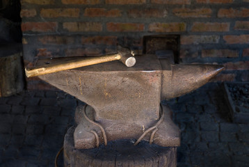 antique anvil with a hammer