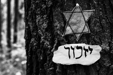 "Hebrew inscription ""yizkor"", remember in hebrew and the name of a prayer in memory of deceased beloveds. Holocaust Remembrance Day"
