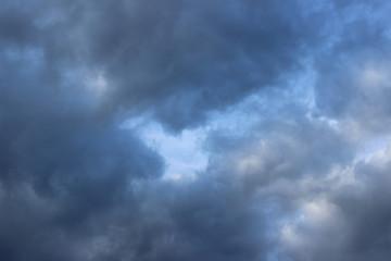 Dark rain clouds on blue sky
