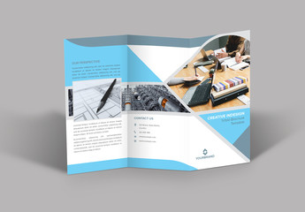 Trifold Brochure Layout with Light Blue and Grey Accents
