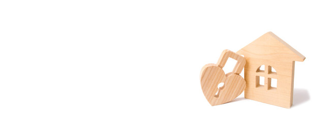 Wooden house with Heart shaped lock on a white background. Love nest, relationships. Buying a house with a young family. Affordable housing. Family, strong relations. Love and offspring banner