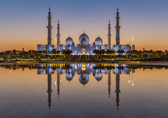 The Sheikh Zayed Grand Mosque in Abu Dhabi after sunset with reflection