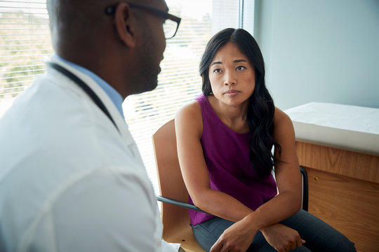 Doctor speaking with a female patient