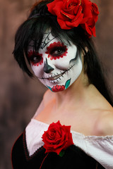 Photo of halloween woman with white make-up on her face