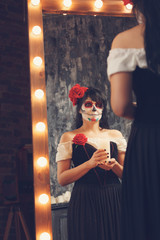 Grim halloween photo girl zombie with white face