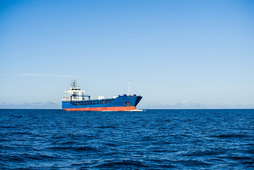 Large cargo ship in the Baltic sea on a sunny day, Latvia