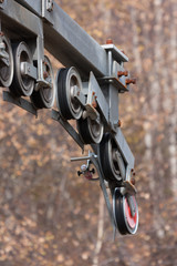 Abandoned wheels of ski lift mast