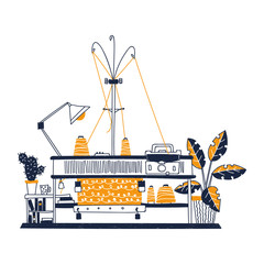 The workplace with knitting machine at home. There is knitting machine, knitted fabric, bobbins, thread, lamp, shelf