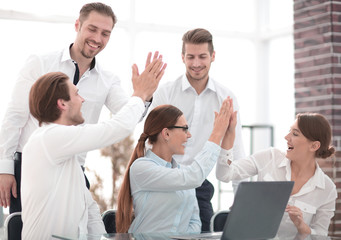 business team starts a business project and giving each other a high five