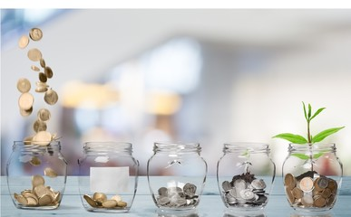 Money Jars with  coins on white background