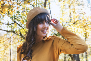 Portrait of beautiful woman with hat,enjoying at autumn day
