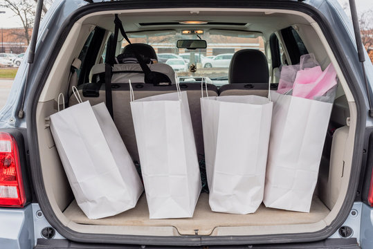 Trunk filled with shopping bags - holiday shopping