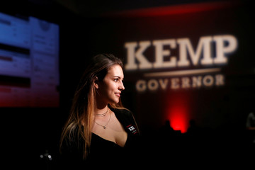 Green gets her photo taken in front of the stage at Republican gubernatorial candidate Kemp's election night party in Athens