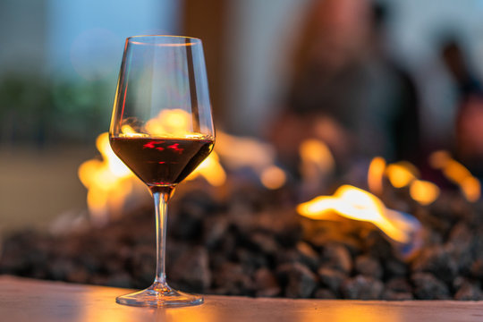 Glass of Red Wine and Fire Pit