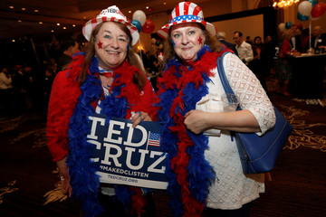 Luann Thomas, left, and Diane Rix pose for a photograph during an election night party for Republican U.S. Senator Ted Cruz in Houston