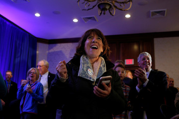 State Rep. Linda DiSilvestro of Manchester watches early election results come in at a Democratic Party election night event in Manchester