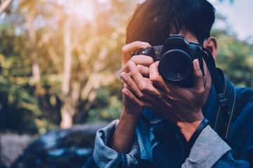 Man holding camera and take photo vintage tone