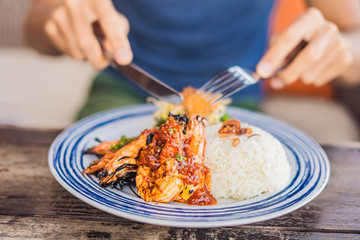 Close up Grilled prawns or fresh grilled shrimps ,cooking seafood with rice. Bali Kitchen