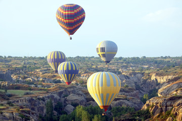 balloon is flying in mountainous area in Cappadocia. Turkey