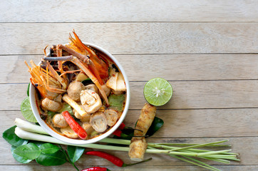 River prawn spicy soup (Tom yum koong) Thai food and ingredient vegetables