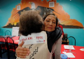 U.S. Democratic Congressional candidate Haaland hugs Tiger at a Native Vote Celebration on midterm elections night in Albuquerque