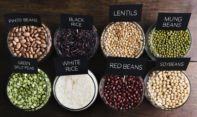 Various types of beans in  glass bowls