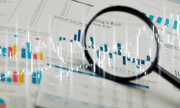 Magnifying glass and business growth graph ,business