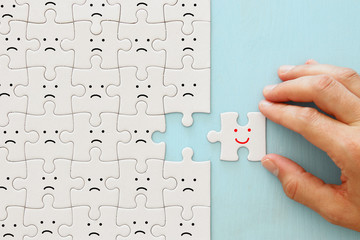 concept image of chosen person among others. a smiling face stands out from the crowd