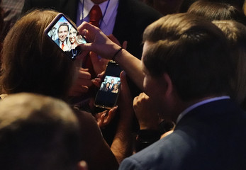 Republican gubernatorial candidate Ron DeSantis takes some photos with supporters at his midterm election night party in Orlando