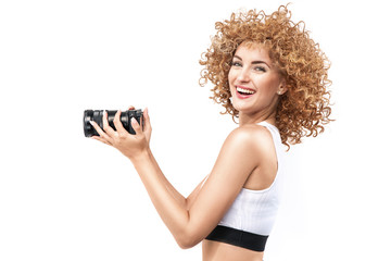 Poster Artist KB Commercial style portrait of a ginger, frizzy-haired woman holding a camera