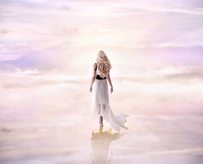 Canvas Prints Artist KB Conceptual picture of a blond lady walking on the delicate, fluffy clouds