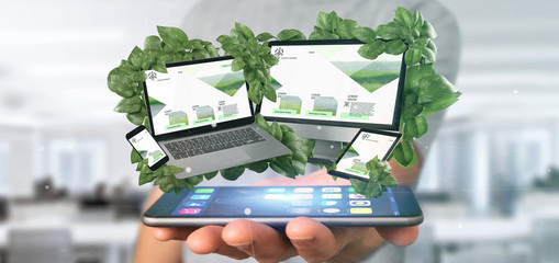 Businessman holding a Connected devices surrounding by leaves 3d rendering