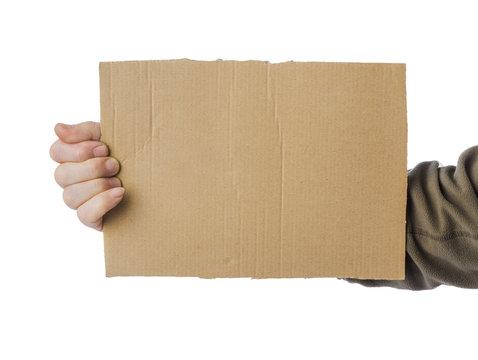 Hand of beggar with cardboard