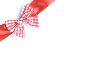 Red ribbon bow in the box isolated on white background