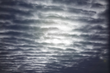 Textured clouds in the night sky