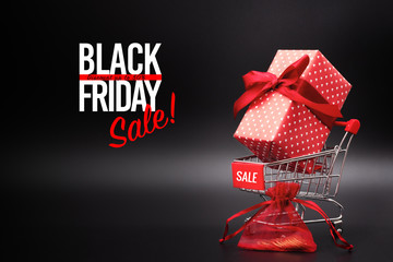 Black Friday sale, shopping cart and gift box with pocket money