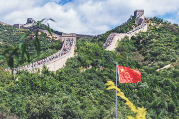 The Great Wall of China. Chinese flag on the background of the Great Wall