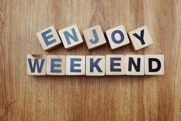 enjoy weekend word alphabet letter on wooden background