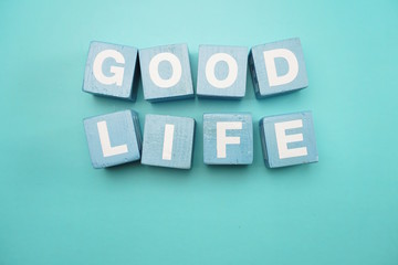 Good Life created with cubes alphabet letters on blue background