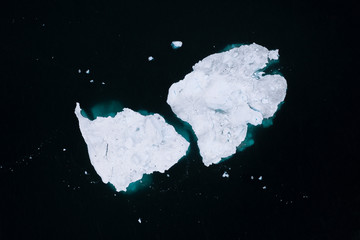 Minimalistic aerial view of icebergs in Greenland