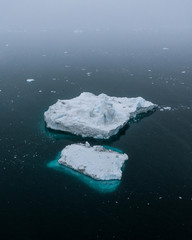 Minimalistic aerial view of an iceberg during a foggy day