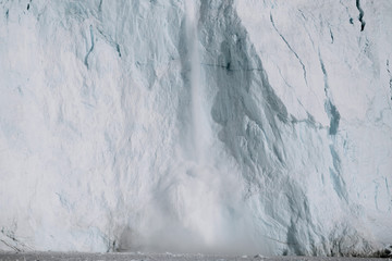 Arctic Glacier calving event from a massive wall of ice