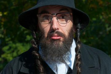 Jewish orthodox man with eyeglasses portrait.