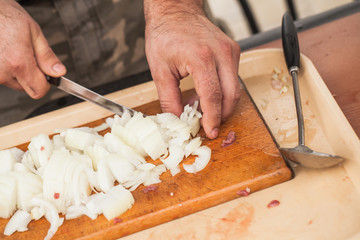White onion manual chopping. Cook hands