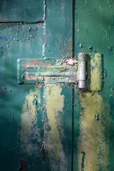 Old textured painted door hinge