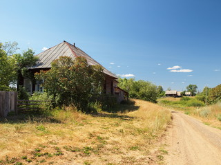 Old Russian wooden house in the village. Russian summer nature. Russia, Ural, Perm region
