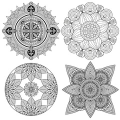Set of four black and white mandala patterns.