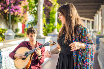 Band performing traditional music fado under pergola with azulejos in Lisbon, Portugal