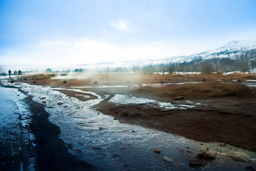 Geysir Hot Spring Area, on a cold day with steam billowing from the springs, Golden circle, Iceland