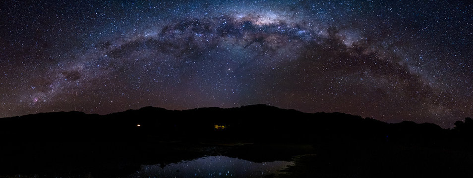 Panorama Starry night Milky way over the mountain. Abel Tasman National Park.
